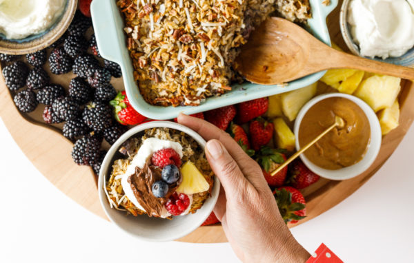 holding a breakfast bowl with baked oats