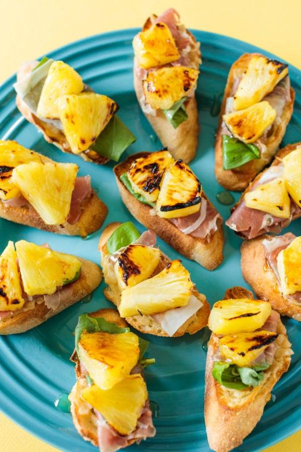 plate of Pineapple Prosciutto Crostini