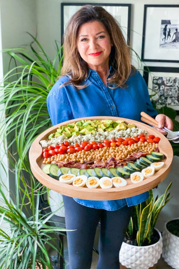 woman holding Chickpea Cobb Salad Board