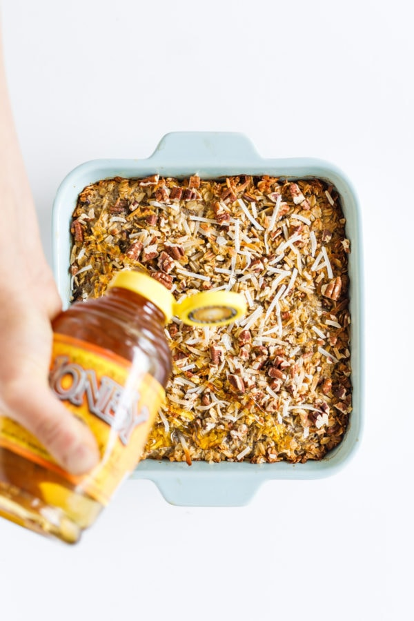 pouring honey on baked oatmeal