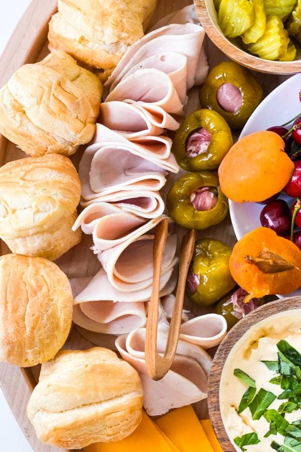 turkey, rolls, and stuffed peppers on a Summer Lunch Turkey Sandwich Board