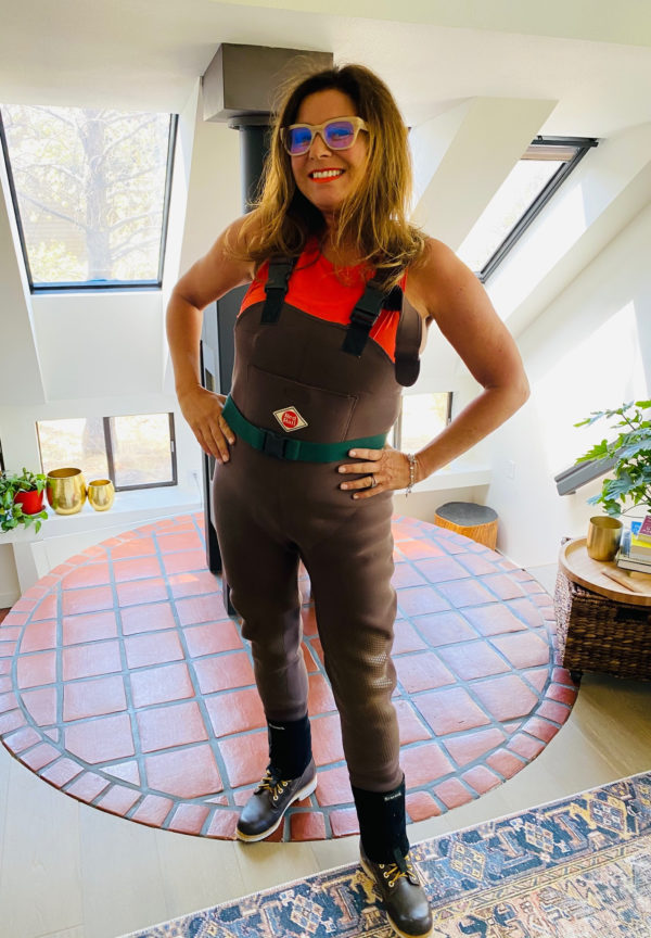 woman in fly fishing waders