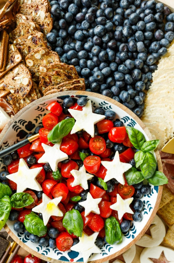 cparese salad with blueberries and white cheese stars