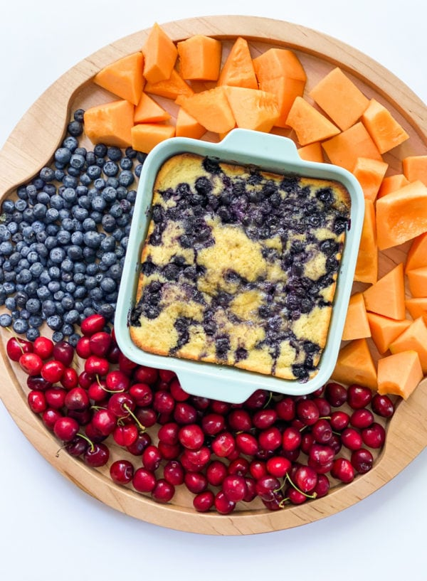 blueberry cake in the center of a fruit board