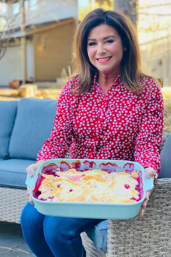 woman holding 9x13 pan Classic Raspberry Cobbler