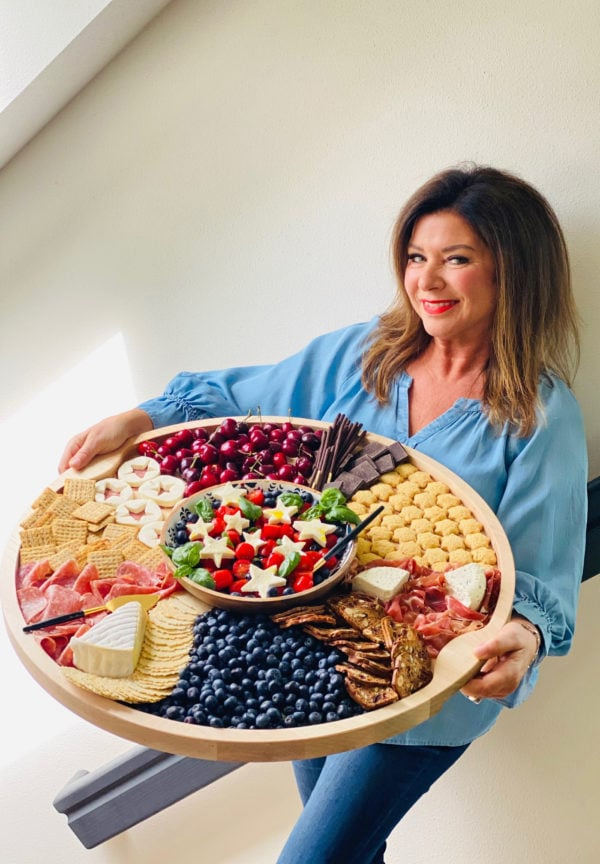 woman holding a Blueberry Patriotic Charcuterie Board