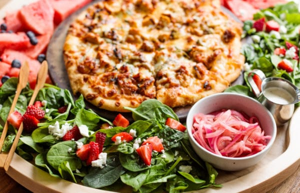 pizza board with pickled red onions