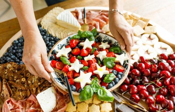 setting down a caprese salad