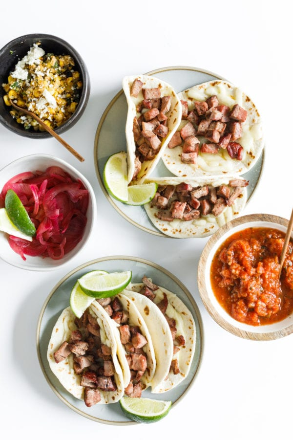 mini tacos on plates with toppings