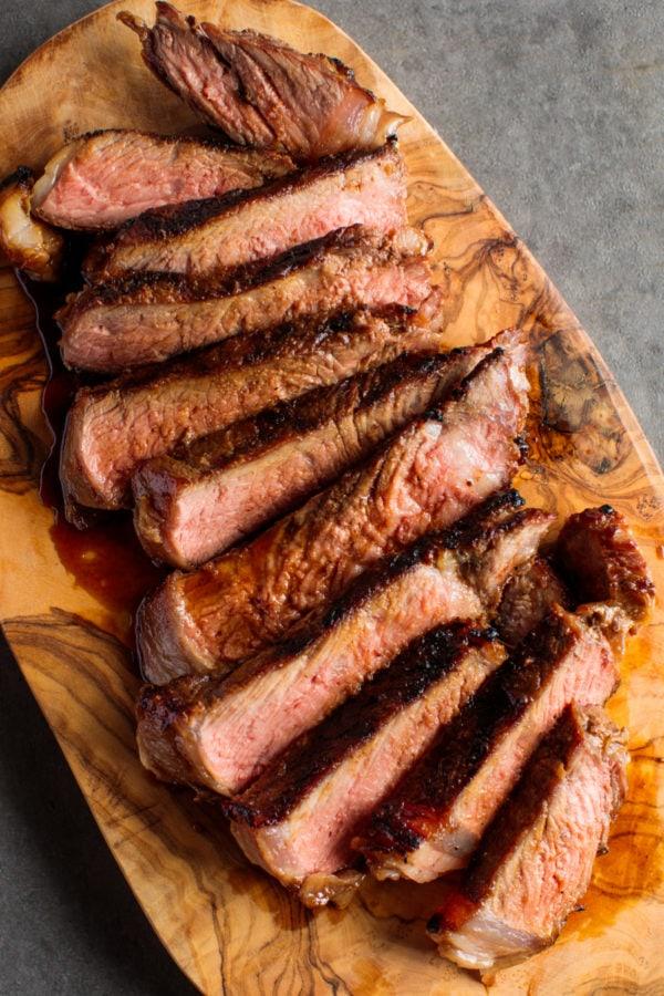 Miso Marinated New York Steak on wood platter