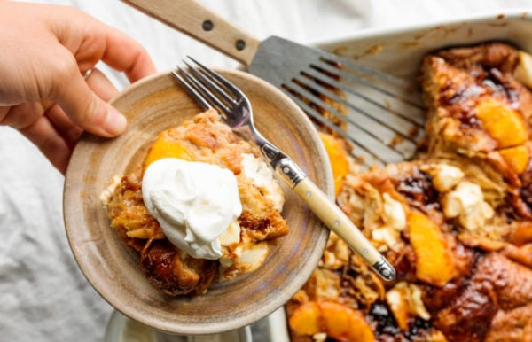 Peaches and Cream Bread Pudding on plate with fork
