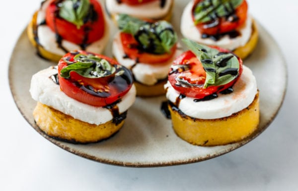 Grilled Polenta Caprese Appetizers on a plate
