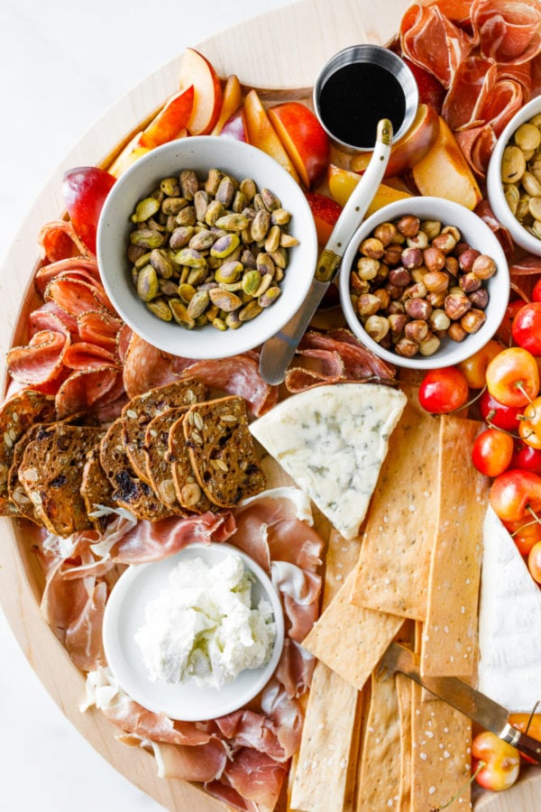 charcuterie board with cheese and nuts