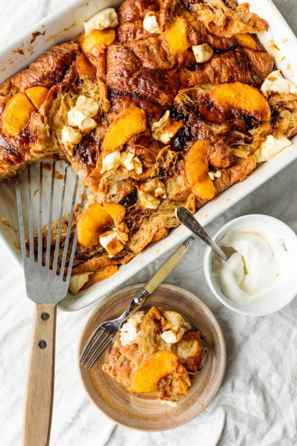 serving of Peaches and Cream Bread Pudding with cream