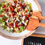 round wood serving bowl of Italian chopped salad