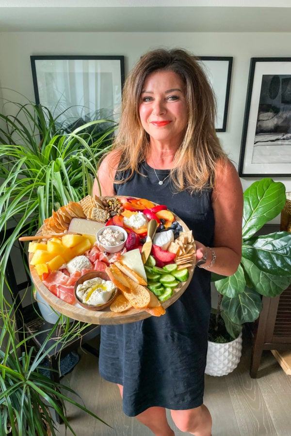 woman holding a Quick Summer Cheese Charcuterie