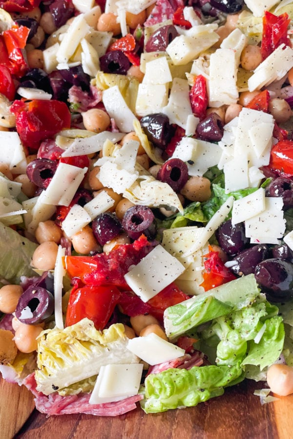 Italian chopped salad with olives, cheese, peppers