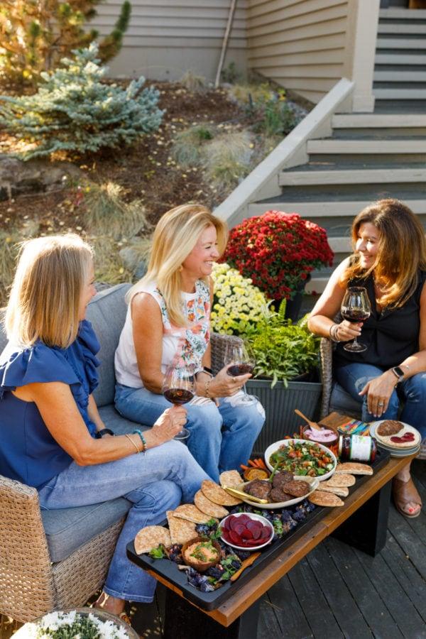 3 women enjoying pita burger board