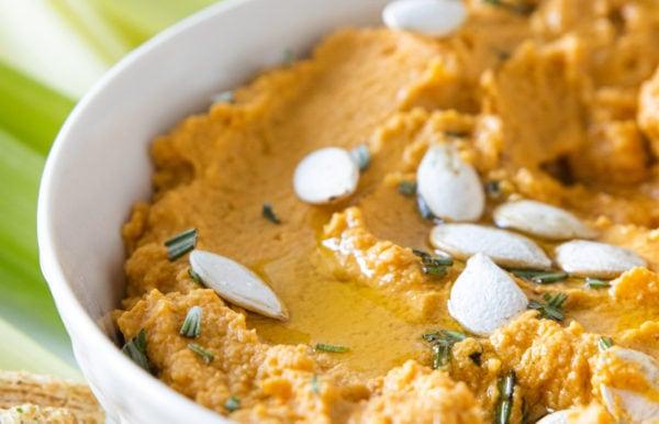 close up pumpkin hummus in a bowl