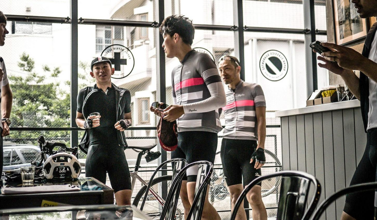 Rapha Cyclists drinking coffee in cafe