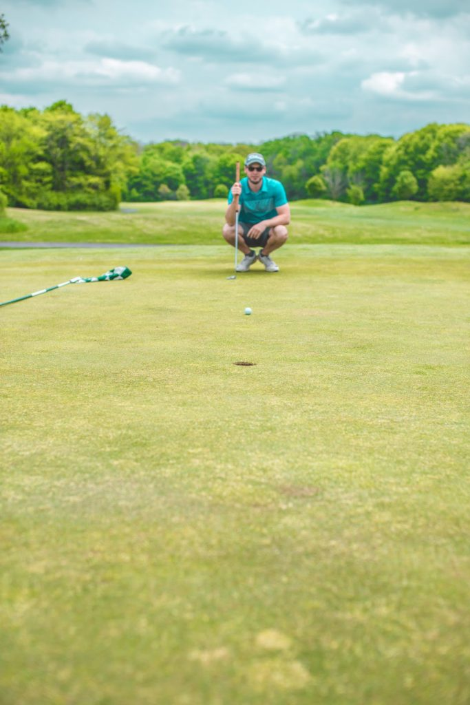 Golfer lining up putt - 5 Golf Tips for Beginners