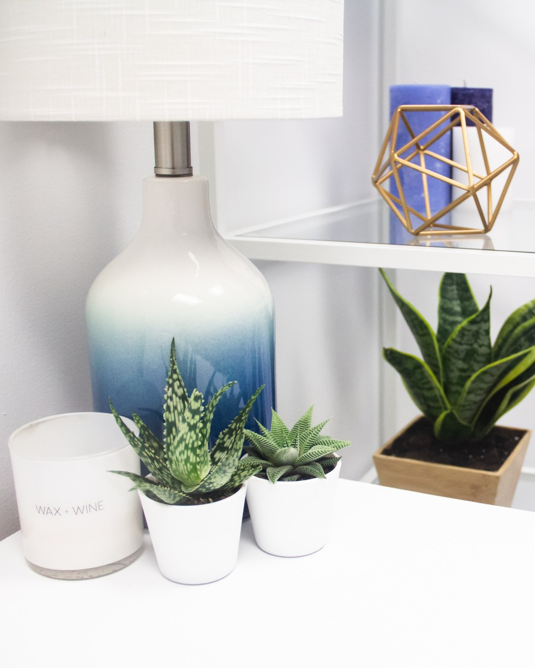 Lamp, succulents, and candle at massage studio