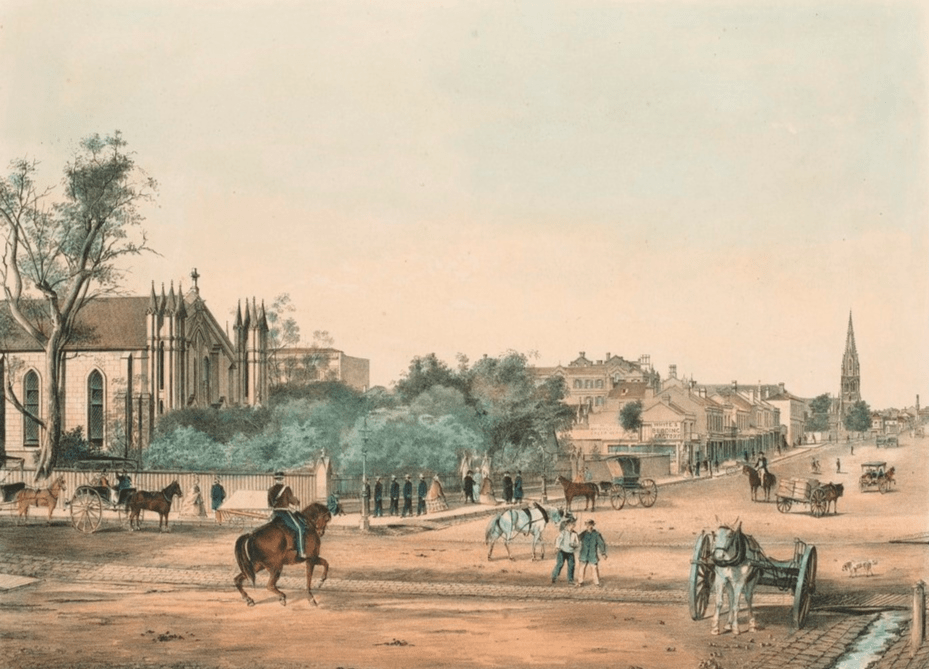 Looking east from Elizabeth Street along Lonsdale Street with St. Francis Catholic Church on left, White's Bedding Factory and church spire in distance. Horse-drawn wagons, carriages and mounted trooper on road, pedestrians on path. Open guttering running along Elizabeth Street with guttering and culverts along Lonsdale.