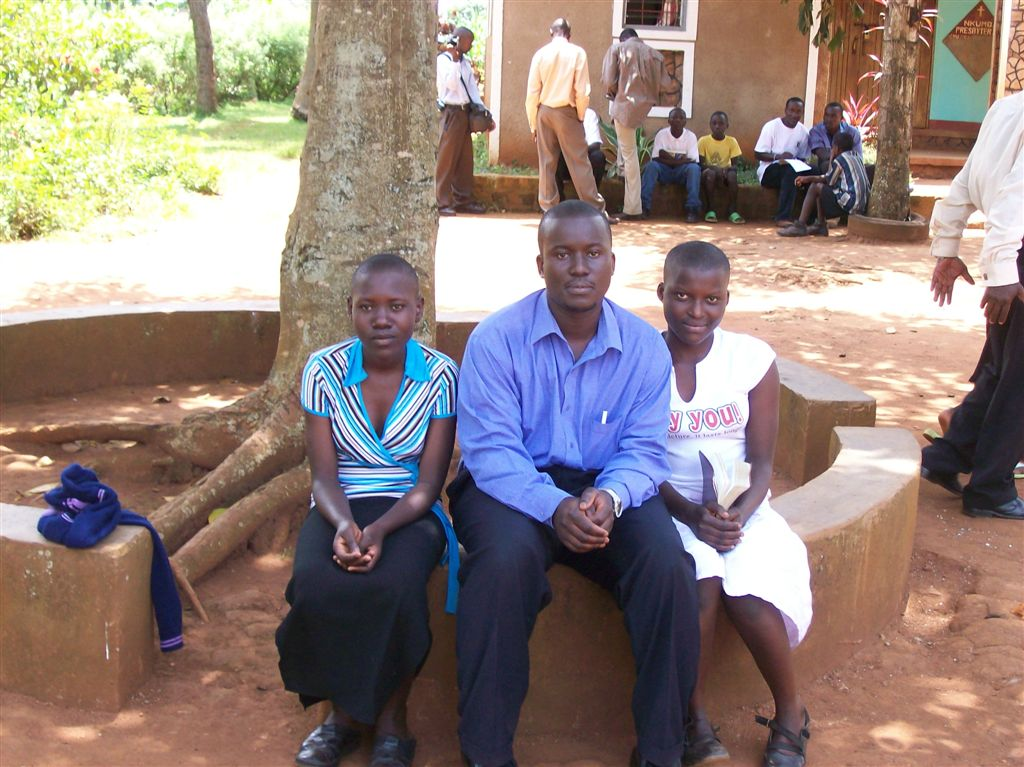 2008- Martin with sisters Flavia and Molly, sitting outside the church