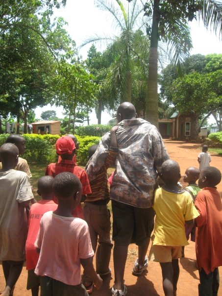 Seggy with kids at Nkumba