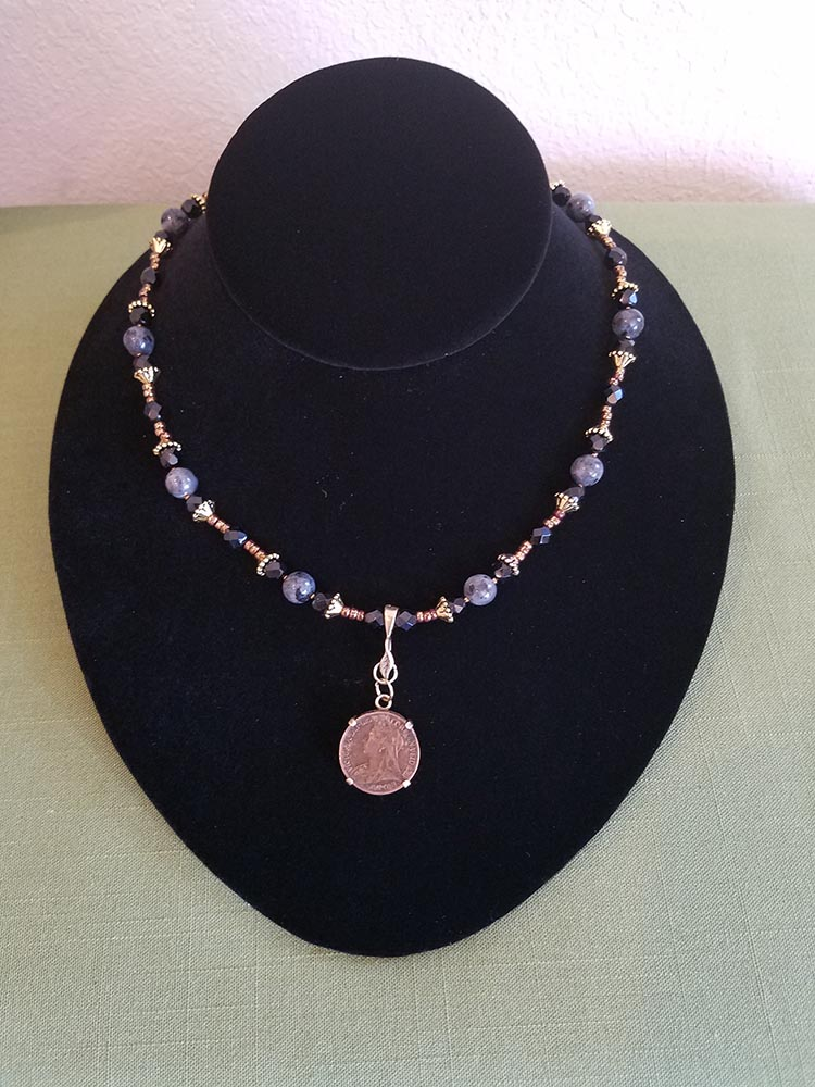 Victorian farthing on strand of black Czech and labradorite beads