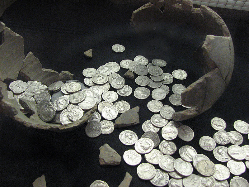 Roman coins in broken pot