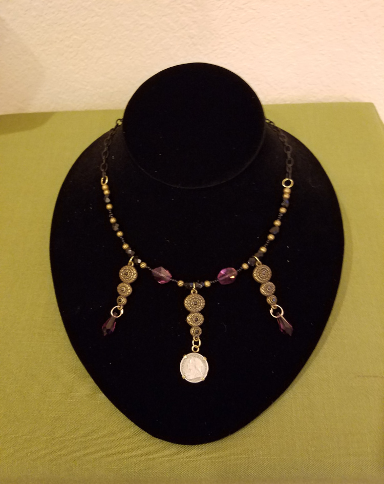 Victorian threepence with black and purple beads necklace