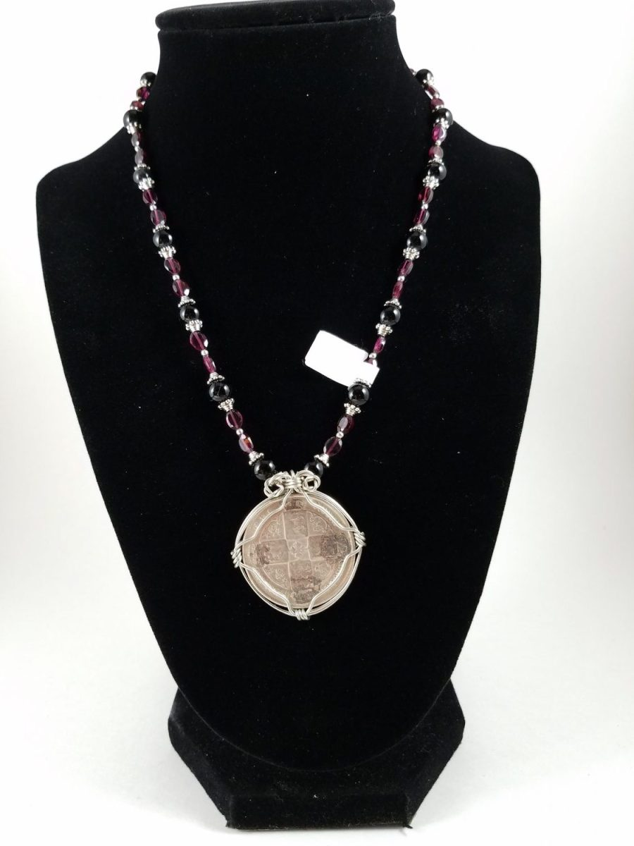 Necklace featuring silver Victorian florin with garnet and agate