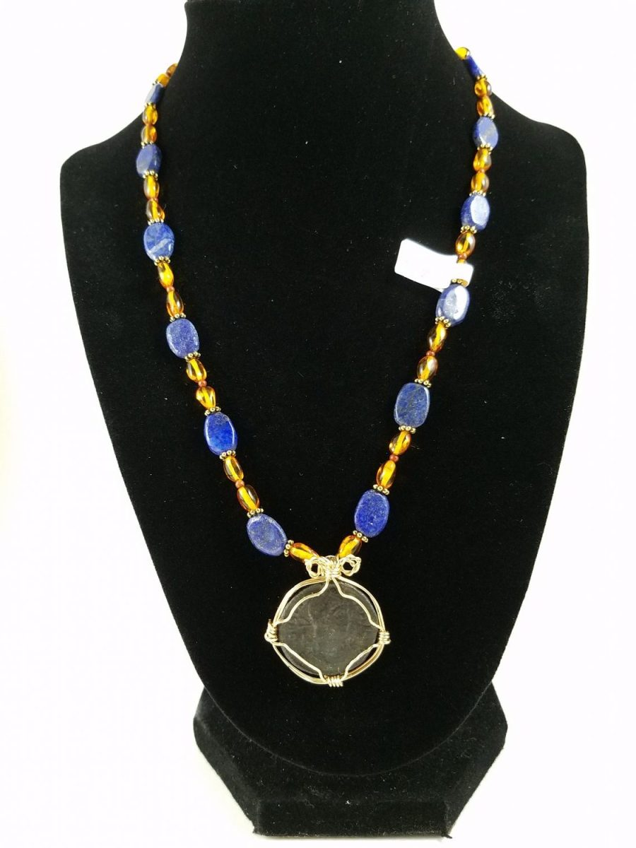 Necklace with lapis lazuli, amber, and roman coin