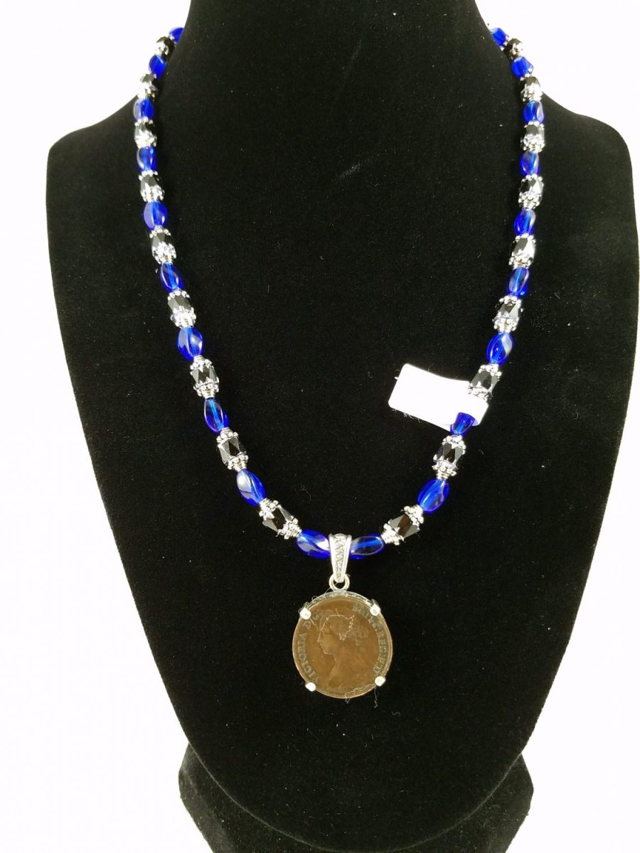 Victorian farthing with deep blue and black glass beads on a necklace