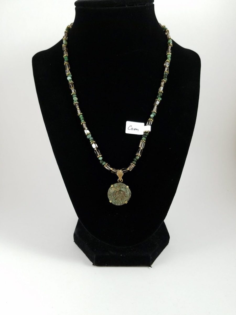 Necklace with emrald chips and roman coin of romulus and remus