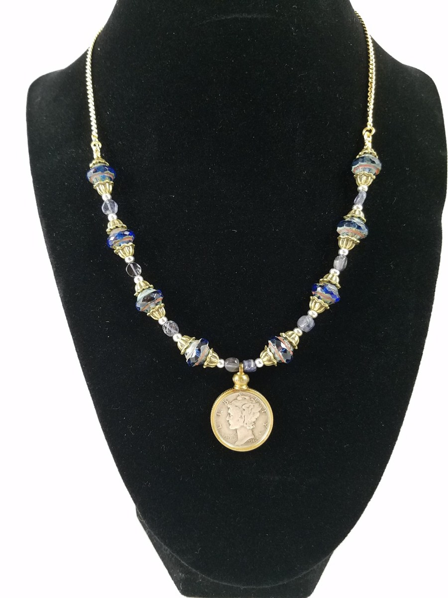 Necklance was blue glass beads and Mercury silver dime