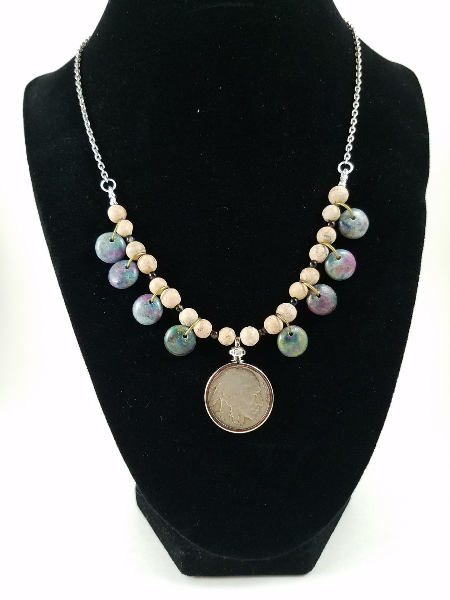 Necklace featuring American buffalo nickel and ruby-infused kyanite.