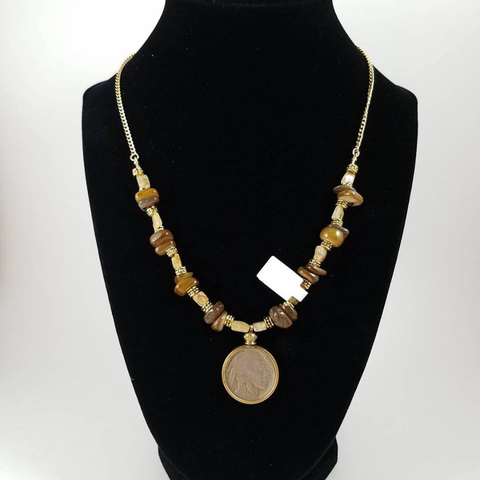 Necklace with Buffalo neckel, yellow citrine and brown stones on a gold tone chain