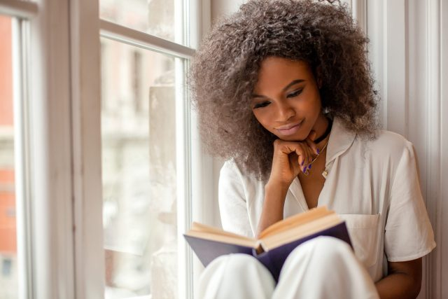 woman reading staying healthy at home
