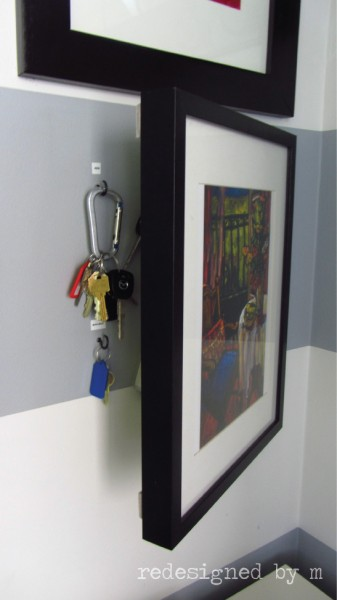 key behind picture frame