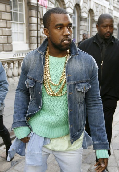 "Kanye West channeling his inner ""late 1980's cheating housewife morning walk of shame"".  Apparently at a major ""fashion"" event."