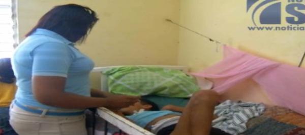 madre Ayudemos a esta familia dominicana