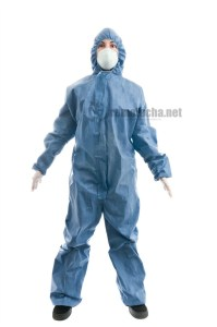 A Caucasian woman wearing a hazmat suit.