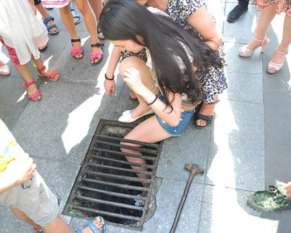Woman Absorbed by Mobile Phone Gets Stuck in Drain