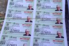 Billetes de la Lotería con la figura del profesor Juan Bosch