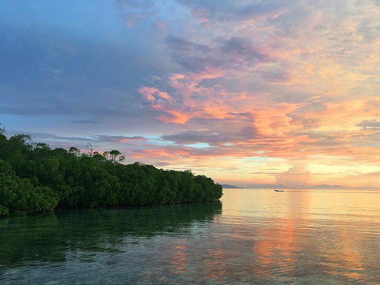 Raja Ampat sunset mangrove first West Papua boat