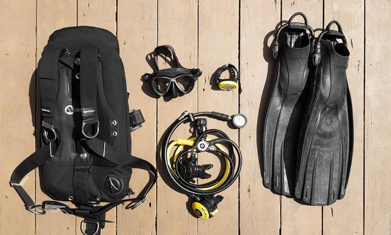 Essential Backpacking scuba equipment laid out on wood decking