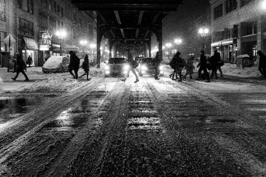 walking in the snow under chicago's L. Photo by Kent Henderson on Unsplash