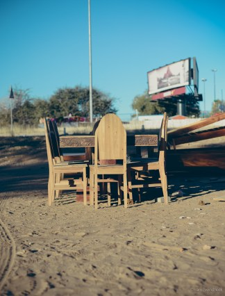 i am | the chairs and tables, waiting for a new home. Auas Road, Windhoek, Namibia.